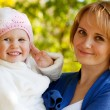 Happy young mother holding a his daughter - Stock Photo