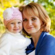 Happy little girl with her mother — Stock Photo #13155739