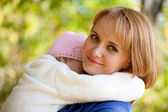 Little girl in the arms of mother — Stock Photo