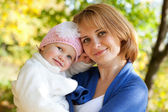 Happy young mother with her daughter — Stockfoto