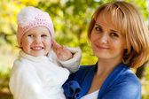 Happy young mother holding a his daughter — Stock Photo