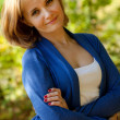 Pretty young woman in a blue pullover - Stock Photo