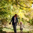 Mother and daughter walking in the forest - Stock Photo