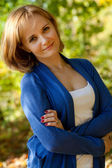 Pretty young woman in a blue pullover — Stock Photo