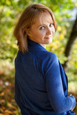 Pretty young woman in a blue sweater — Stock Photo
