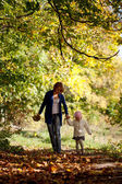 Mother and daughter walking in the forest — Stock Photo