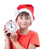 Girl in a Santa Claus hat — Stock Photo