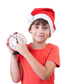 Smiling girl in a Santa Claus hat — Stock Photo
