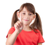 Cheerful girl with a raised finger — Stock Photo