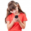 Little girl with a mobile phone — Stock Photo