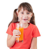 Pretty little girl with a glass of juice — Stock Photo