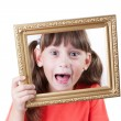 Little girl holding a frame for pictures — Stock Photo #13979661