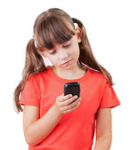 Little girl with a phone in his hand — Stock Photo