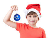 Girl holding a Christmas toy — Stock Photo