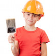 Cute kid with a paint brush — Stock Photo