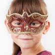 Charming girl in a carnival mask — Stock Photo
