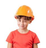 Little girl in a protective helmet winks — Stock Photo