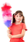 Little girl with a broom to clean the dust — Stock Photo