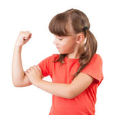 Little girl touches the biceps — Stock Photo