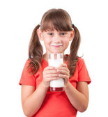Little girl with a glass of buttermilk — Foto de Stock