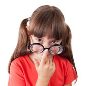 Girl corrects glasses on his nose — Stock Photo