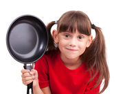 Little girl holding a frying pan — Stock Photo