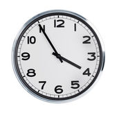 Round wall clock on a white background — Stock Photo
