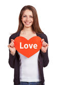 Pretty young girl holding a heart — Stock Photo