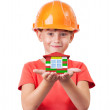 Little girl holding toy house — Stock Photo