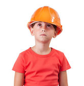Girl in an orange helmet looking up — Stock Photo