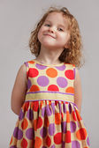 Little happy girl in a bright dress — Stock Photo