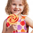 Stock Photo: Happy little girl with a lollipop