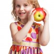 Stock Photo: Happy little girl with an apple in his hand