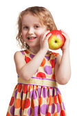 Happy little girl with an apple in his hand — Stock Photo