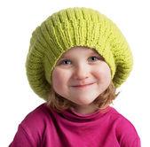 Happy little girl in a knit cap — Stock Photo