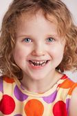 Happy charming curly little girl — Stock Photo