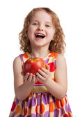 Happy cheerful girl with a ripe apple — Stock Photo