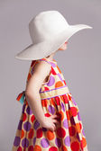 Little girl in a fashionable hat — Stock Photo