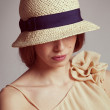 Cute girl in braided straw hat — Stock Photo