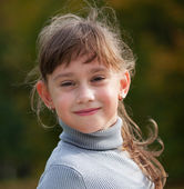 Little girl in a gray sweater — Foto de Stock