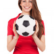 Athletic girl holding a soccer ball — Stock Photo #22417951