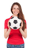 Athletic girl holding a soccer ball — Stock Photo
