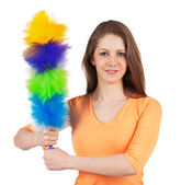 Woman with a brush to clean the dust — Stock Photo