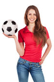 Girl in jeans with soccer Ball — Stock Photo