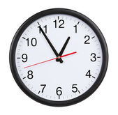 Office clock shows five minutes to an hour — 图库照片