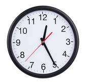 Office clock shows half of the first — Stock Photo