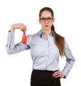 Woman in glasses holding a deflated balloon — Stock Photo