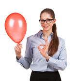 Girl with inflated balloon shows that all okay — Stock Photo