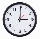 圆形的钟是整整三小时 — 图库照片