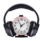 Headphones, put on a round clock — Stockfoto